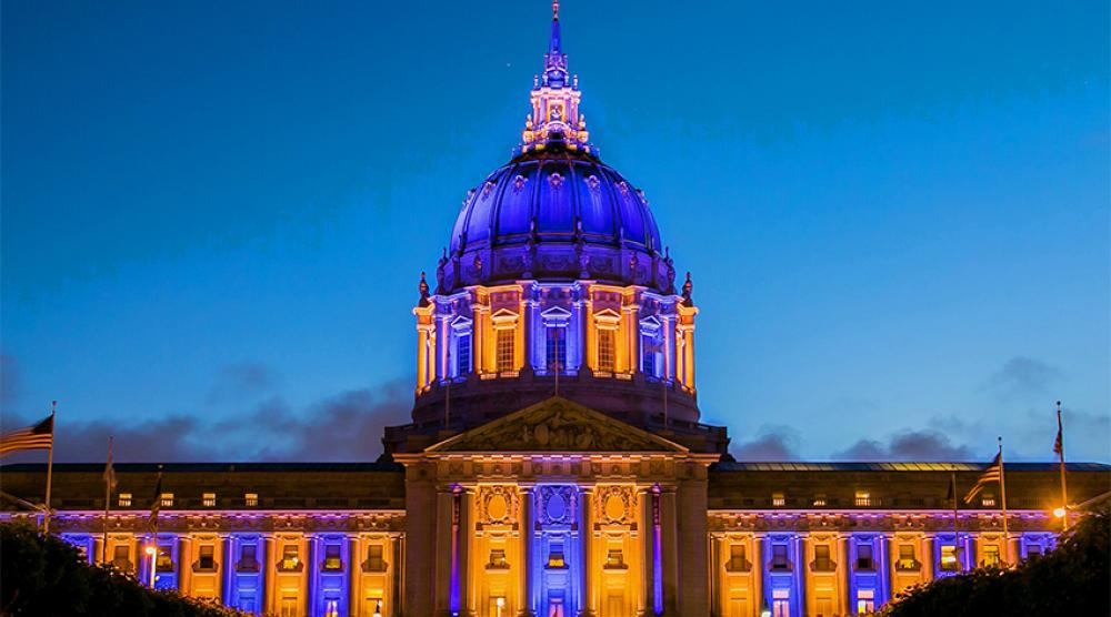 SF City Hall, lit up in purple and green